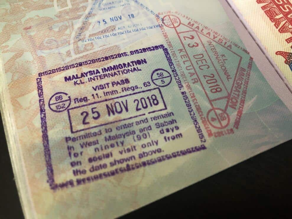 KL tourist visa stamp in passport