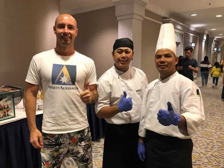 A photo of Marty Spargo and 2 of the staff at the Marriot all you can eat breakfast buffet in Kuala Lumpur
