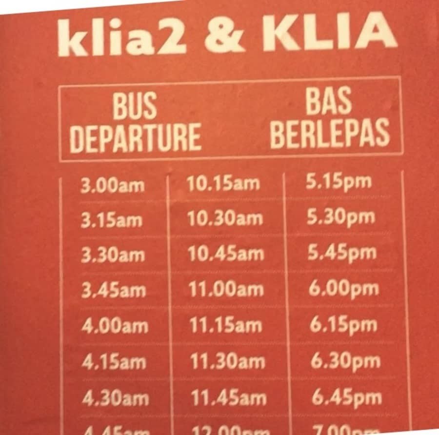 A sign showing some of the bus departure times from KL Sentral.